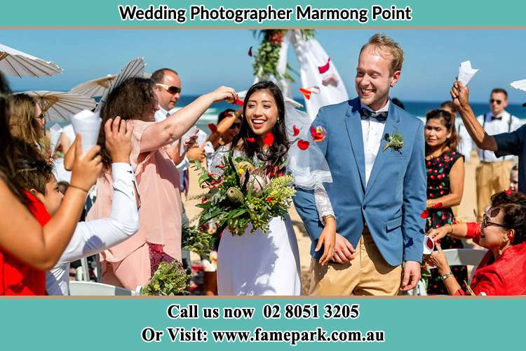 Photo of the Bride and the Groom showering flower petal by the visitors Marmong Point NSW 2284