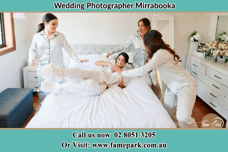 Photo of the Bride and the bridesmaids playing on bed Mirrabooka NSW 2264