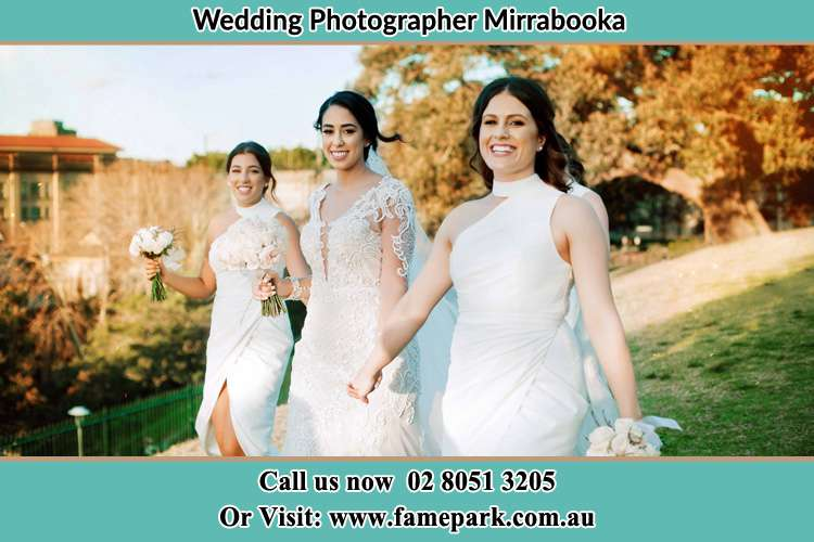Photo of the Bride and the bridesmaids walking Mirrabooka NSW 2264