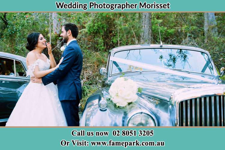 Photo of the Bride and the Groom near the bridal car Morisset NSW 2264