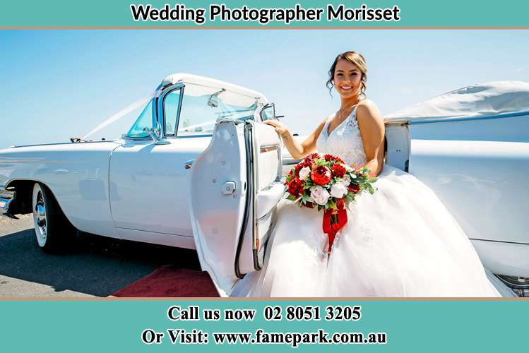 The Bride sitting on the Bridal car Morisset