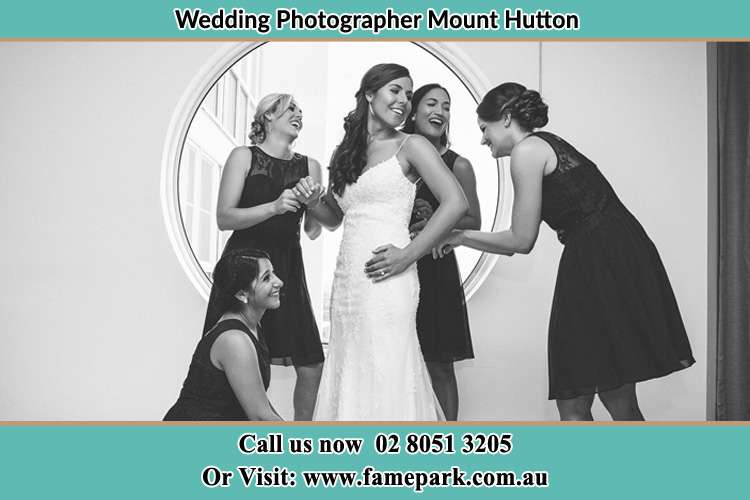 Photo of the Bride and the bridesmaids near the window Mount Hutton NSW 2290