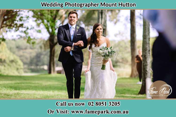 Photo of the Groom and the Bride walking Mount Hutton NSW 2290