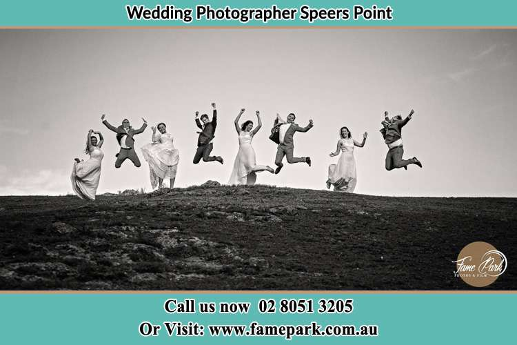 Jump shot photo of the Groom and the Bride with the entourage Speers Point NSW 2284