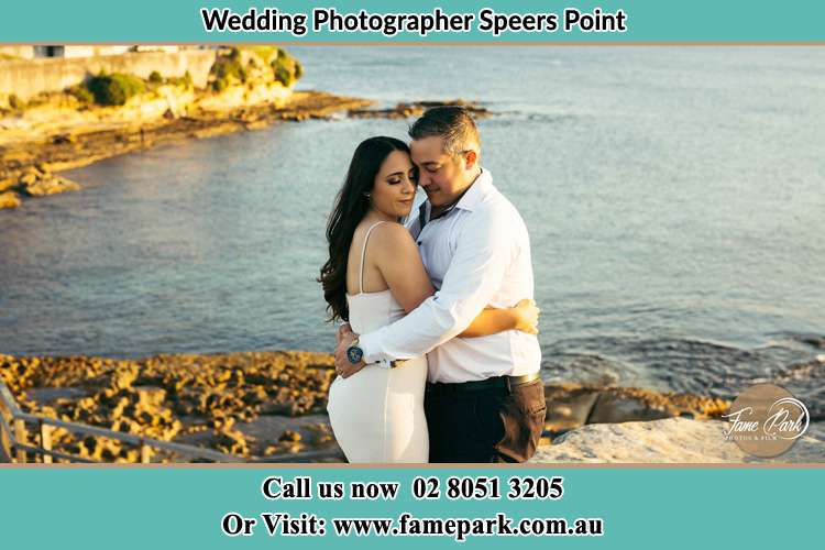 Photo of the Bride and the Groom hugging near the lake Speers Point NSW 2284