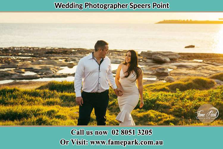 Photo of the Groom and the Bride walking near the lake Speers Point NSW 2284