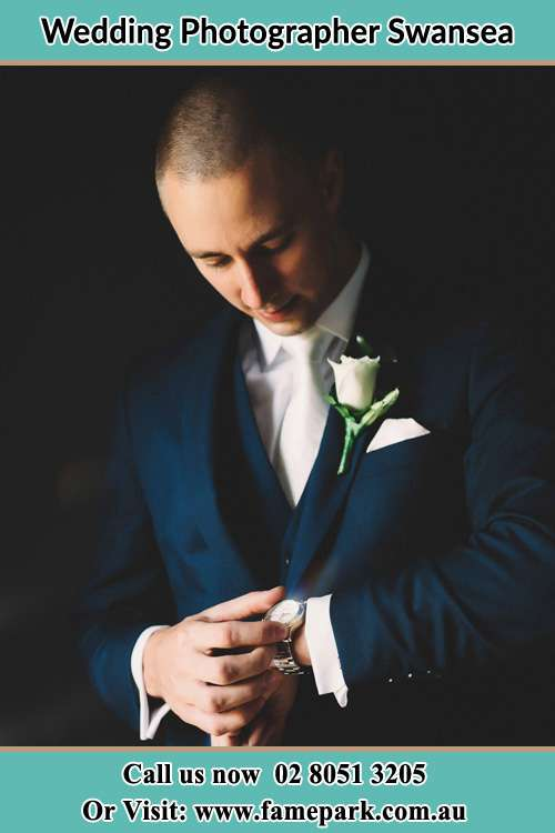Photo of the Groom checking the time Swansea 2281