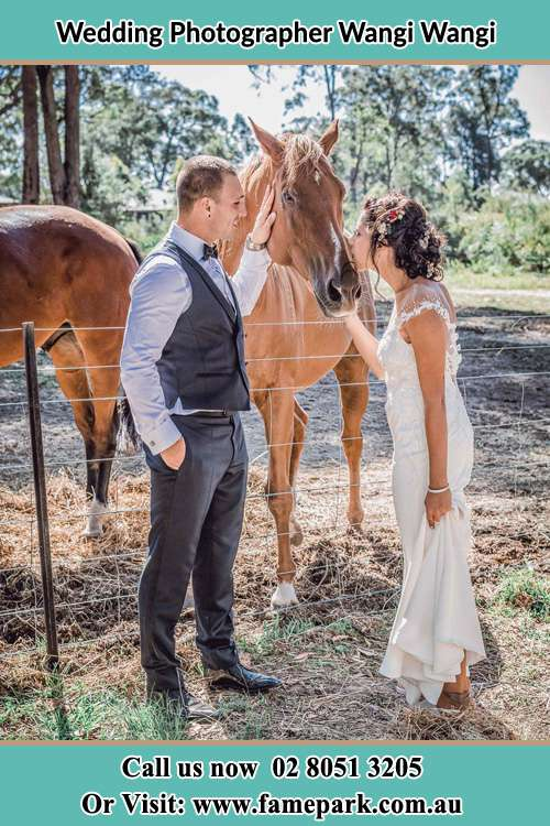 Photo of the Groom and the Bride caressing a horse Wangi Wangi NSW 2267