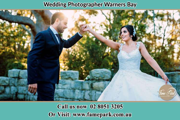 Bride and Groom dance outside Warners Bay
