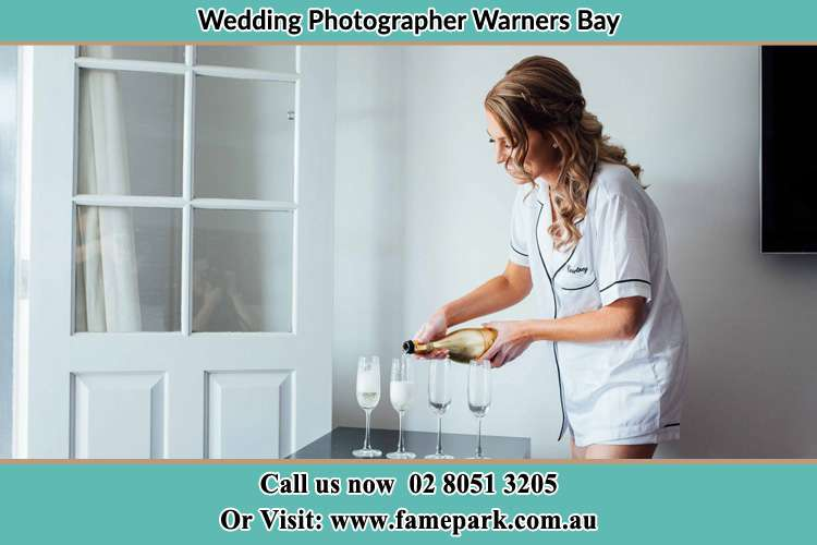 Photo of the Bride pouring wine on the glasses Warners Bay NSW 2282