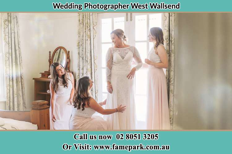 Bride preparing with the help of her bride's maids West Wallsend