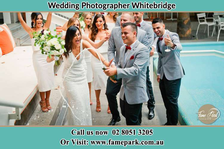 Bride and Groom party in the poolside Whitebridge