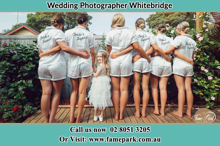 Behind photo of the Bride and the bridesmaids with the flower girl looking back Whitebridge NSW 2290