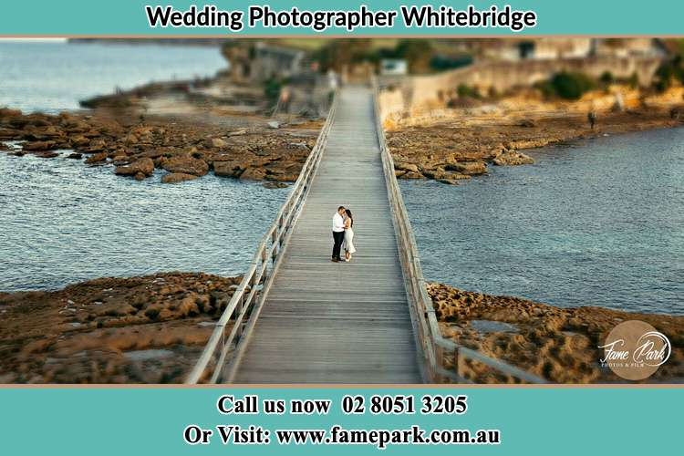 Bride and Groom in the middle of the bridge Whitebridge