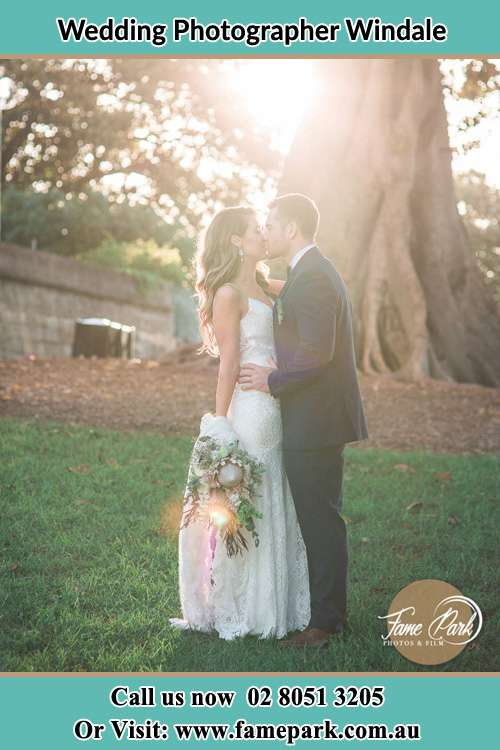 Photo of the Bride and the Groom kissing at the yard Windale NSW 2306
