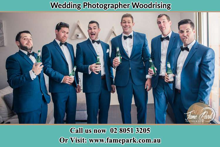 The groom and his groomsmen striking a wacky pose in front of the camera Woodrising NSW 2284