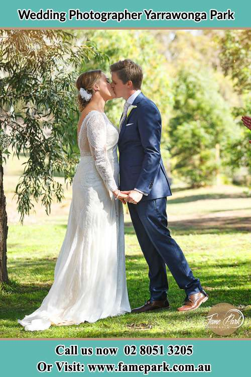 Photo of the Bride and the Groom kissing at the yard Yarrawonga Park NSW 2264